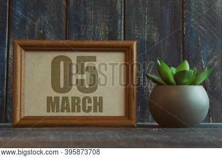 March 5th. Day 5 Of Month, Date In Frame Next To Succulent On Wooden Background Spring Month, Day Of