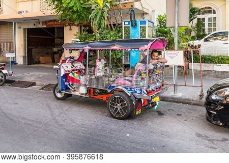 Bangkok, Thailand - December 7, 2019: Tuk-tuk Driver Sleeping In His Vehicle Before Next Customer Ju