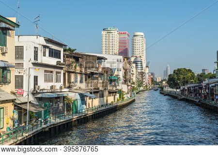 Bangkok, Thailand - December 7, 2019: Street View Of Bangkok At Day With Old Residential Buildings A
