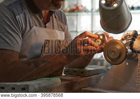 A Craftsman Working In The Sculpting Department At The Waterford Crystal Factory, In The City Of Wat