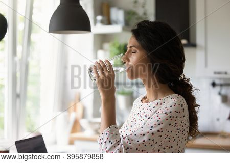 Thirsty Young Woman Drink Clean Mineral Water