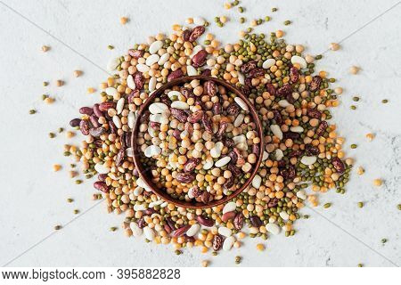 A Wooden Bowl With Assorted Mixed Legumes Scatter Top View Flat Lay