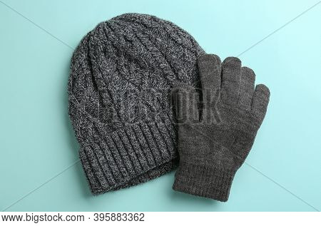 Woolen Gloves And Hat On Light Blue Background, Flat Lay
