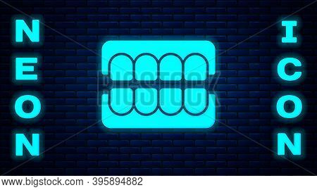 Glowing Neon False Jaw Icon Isolated On Brick Wall Background. Dental Jaw Or Dentures, False Teeth W