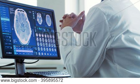 Professional Medical Doctor Working In Hospital Office Using Computer Technology. Medicine, Neurosur
