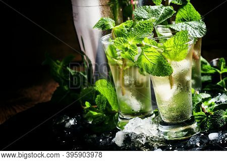 Alcoholic Cocktail With Vodka, Mint Tea, Lemon Juice, Ice, Sugar Syrup And Fresh Peppermint, Black B