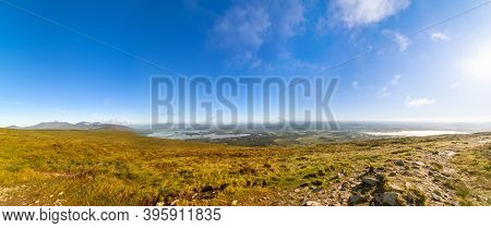 Panoramic View Of Lough Leane With Ross Island In Horizon And The Slopes Of Mount Mangerton On A Sun