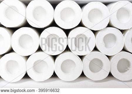 Lots Of White Cigarette Acidic Filters With An Air Chamber. Close-up. Background Or Backdrop. Macro