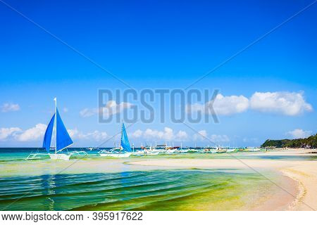 Traditional Filipino Boat At The Idyllic White Sand Beach At Boracay Island In Philiphines