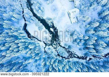 Winter Background. Aerial View. Snowy Trees. Christmas Ice Nature From Above. Snowy Forest At Blue M
