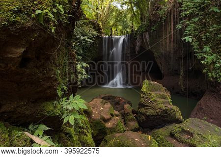 Beautiful Waterfall In Rainforest. Tropical Landscape. Slow Shutter Speed, Motion Photography. Foreg