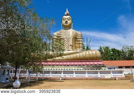 Dikwella, Sri Lanka - February 17, 2020: View Of A Giant Seated Buddha Sculpture (buddha With A Hous