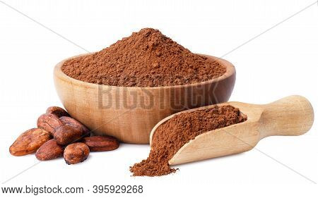 Cacao Powder In Wooden Bowl And Heap Of Beans Near Isolated On White Background