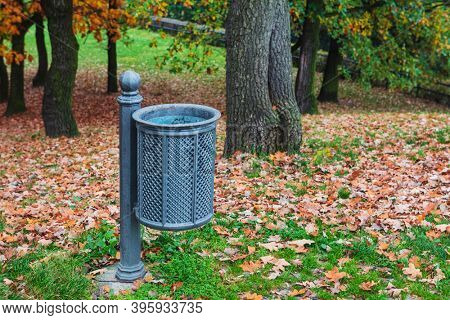 trash can in the autumn park