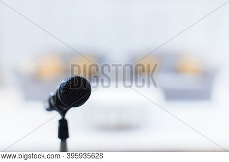 Microphone In Concert Hall Or Conference Room Soft And Blur Style For Background. Microphone Over Th