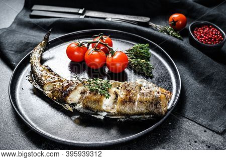 Baked Pollock Cooked In A Savory Marinade. Black Background. Top View