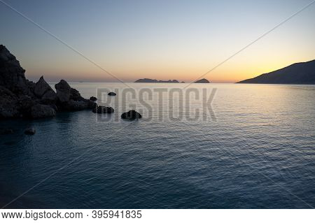 Sunset Over Calm Ocean. Beautiful Seascape Of Sun Setting Over Calm Sea Water. Perfect Place For Ins
