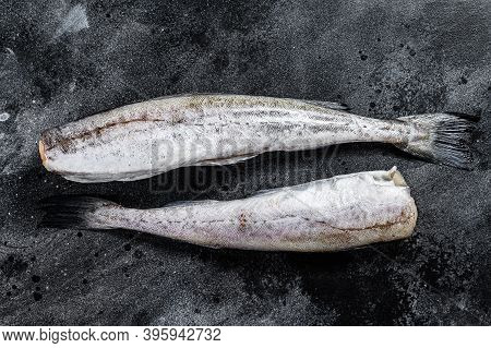 Raw Pollock Fish Ready To Cook. Black Background. Top View