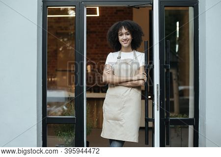 Owner Of Cafe Opening Restaurant After Lockdown Or Barista Greets Guests And Clients. Young African