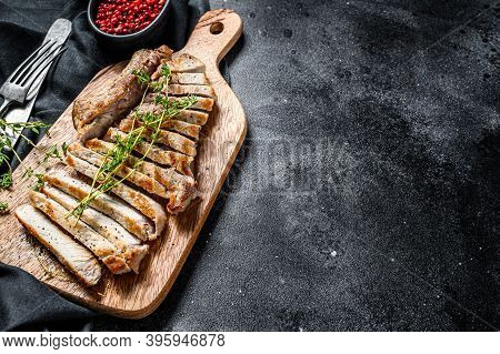 Sliced Grilled Pork Cutlets. Organic Meat Steak. Black Background. Top View. Copy Space