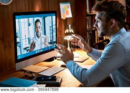 Caucasian Business Man Talking With African Male Partner Coach On Video Conference Call Discussing S