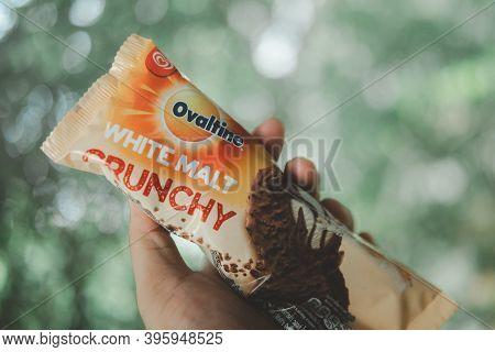 Bangkok, Thailand - November 22, 2020 : Hand Hold A Packed Of Ovaltine White Malt Crunchy Ice Cream