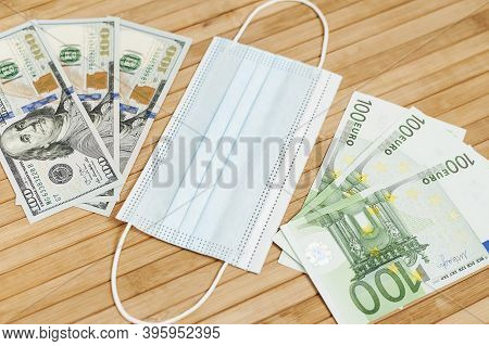 Money Dollars, Euro Banknotes Bill With Face Mask. Crisis And Finance Concept. Covid-19 Coronavirus,