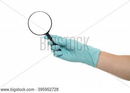 Man's Hand Holding Magnifying Glass, Close Up Isolated On White Background, Copy Space For Your Text