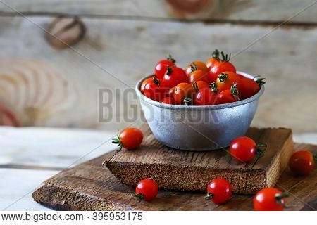 Cherry Tomatoes In A Bowl. Cocktail Tomatoes. Mini Tomatoes With Tails.