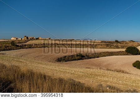 Recently Sown Fields With Semi-destroyed Sheepfolds And The Peak Of Moncayo In The Background