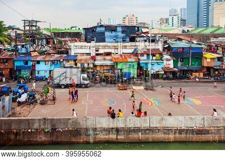 Manila, Philippines - March 18, 2013: Poor Local Houses In Slum Neighbourhood Of Manila City In Phil