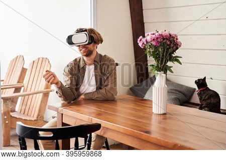 Man Having Skype Or Zoom Chat With New Techologyes