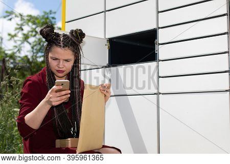 After Opening The Mailbox And Taking Out All The Parcels, The Girl Carefully Checks All Senders.