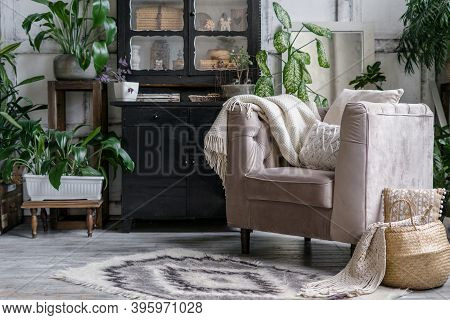 Vintage Chest Of Drawers Near Comfort Armchair With Soft Plaid And Cushions. Cozy Living Room With H