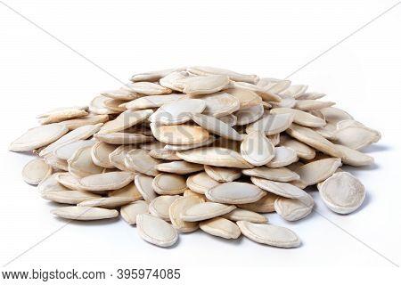 Raw Dried Pumpkin Seeds Isolated On White. Heap Of Pumpkin Seeds