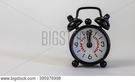 Time To Upgrade Concept. Beautiful Black Alarm Clock With Words 'time To Upgrade'. White Table. Beau