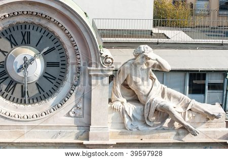 Clock And Man Statue