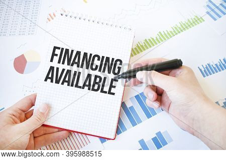 Notepad With Text Financing Available. Diagram And White Background