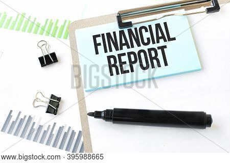 Paper Plate,marker, Diagram,chart And Office Tools. Text Financial Report