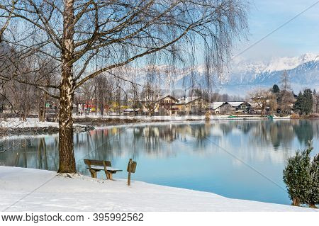 Zell Am See In Winter. View From Esplanade Over Lake Zell To Prielau Town. Idyllic Scene With Bank,