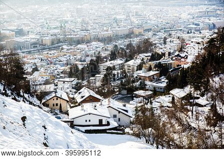 Innstruck In Winter, Austria. Beautiful Aerial View, House Roofes Covered With Snow, Alps Mountains