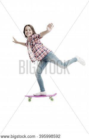 Street And Park Skateboarding. Happy Child Ride Penny Board. Little Girl Perform Skateboarding Trick