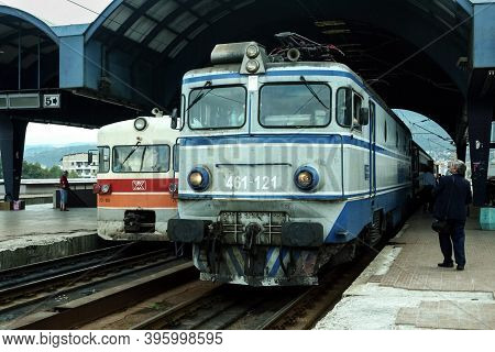 Skopje, Macedonia - September 19, 2009: Passenger Trains, Dmu 712 And Electric Locomotive 461 Class