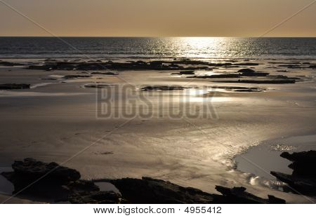Footprints On Beach In Afternoon