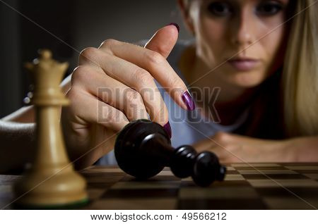 woman surrendering her king in chess