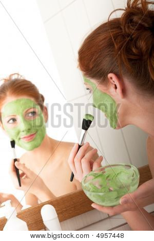 Body Care Series - Young Woman Applying Green Facial Mask