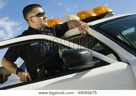 Police Officer Leaning on Patrol Car