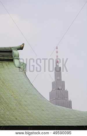 Modern Skyscraper Behind Traditional Roof of Meiji Shrine