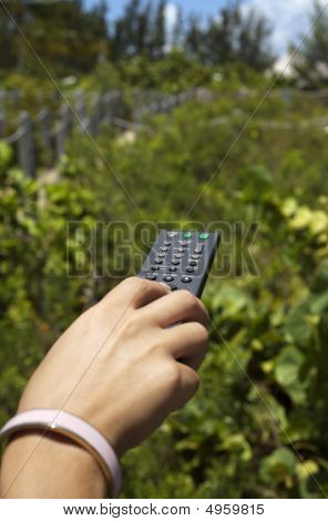 Young Woman Uses Remote Control Outside