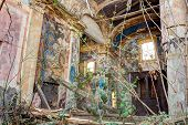 interior of an abandoned and dilapidated church with rubble and debris - ruins of catholic old church collapsed during earthquake poster